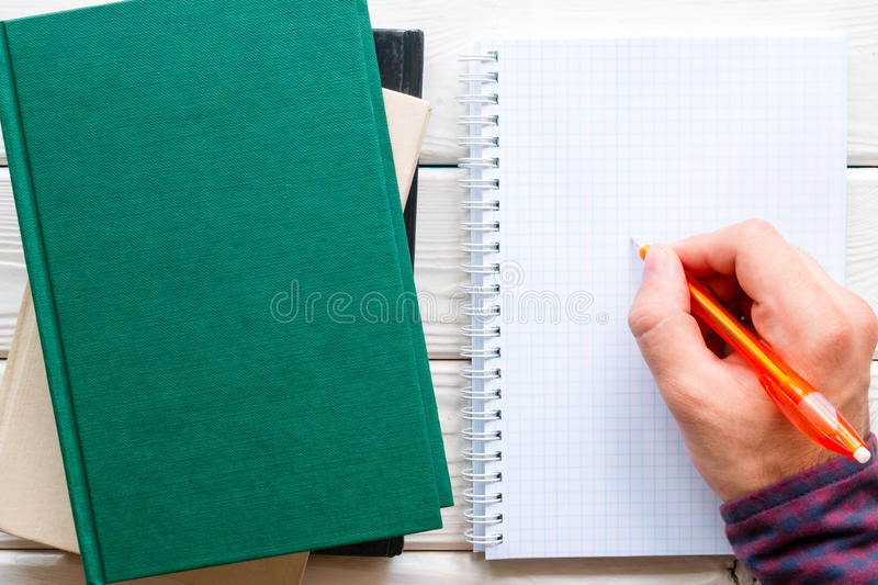 Student doing homework, writing in a notebook royalty free stock images