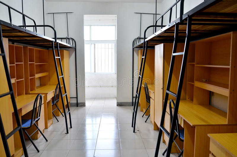 Student dorm. Bunk beds and cabinets in a student dorm