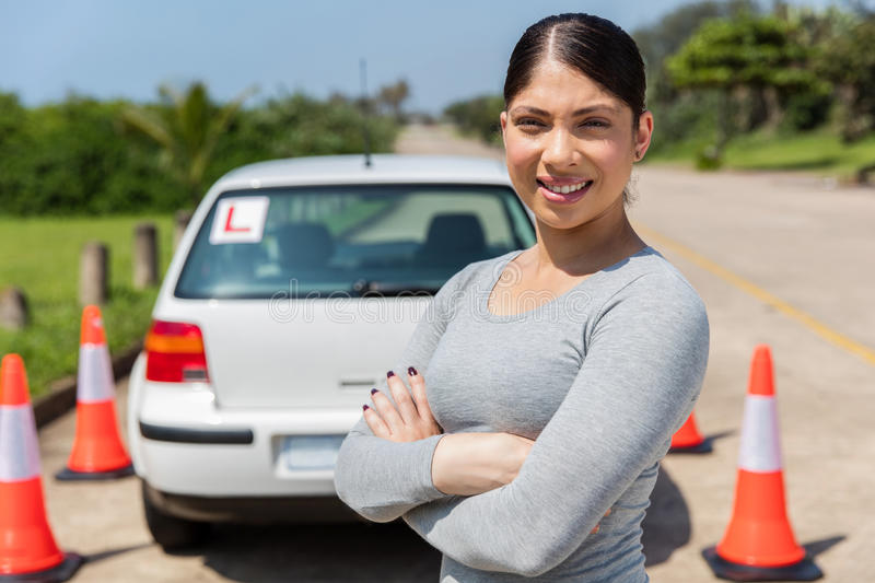 Student driver testing ground. Female student driver in testing ground stock image