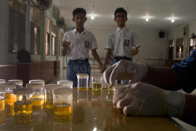 STUDENT DRUG URINE TEST. Students of 6th Surakarta High are attending mandatory drug urine test on their school in Solo, Java, Indonesia royalty free stock images