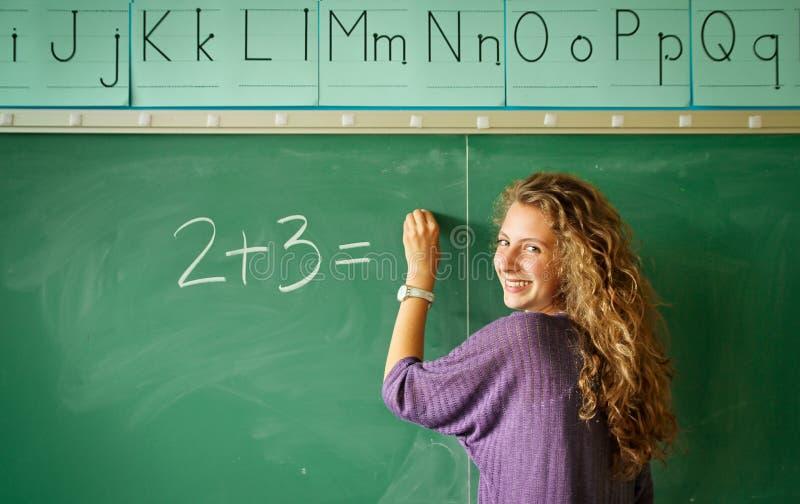Student in een klaslokaal stock foto's