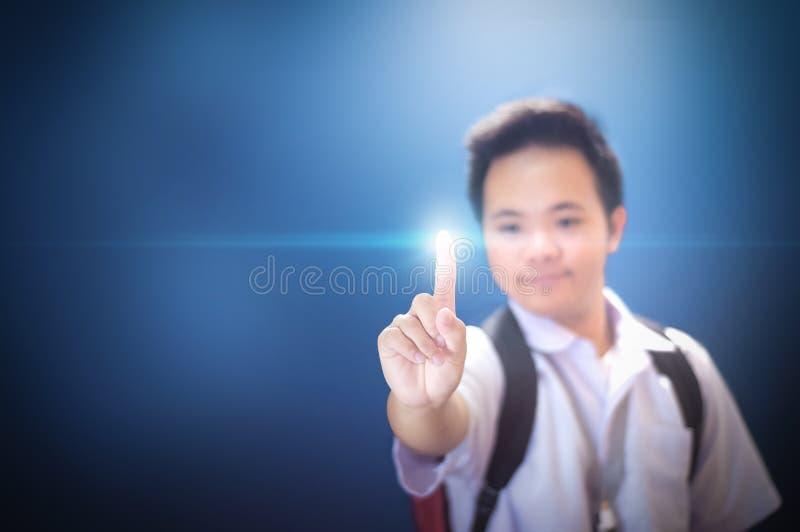 Student för skolapojke som väljer genom att använda pekfingret royaltyfri foto
