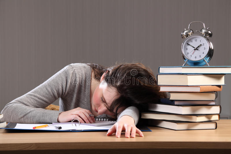 Student falls asleep doing homework late at night stock image