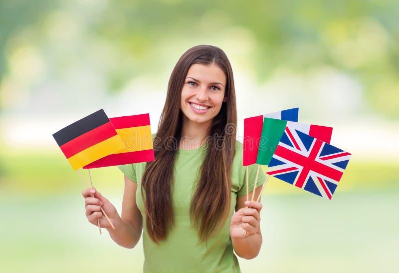 Student Female met Internationale Vlaggen stock afbeeldingen