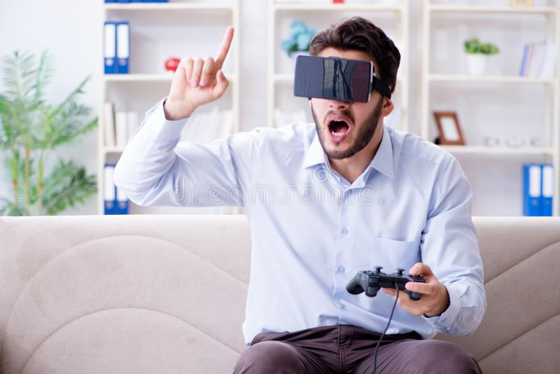 The student gamer playing games at home royalty free stock photo