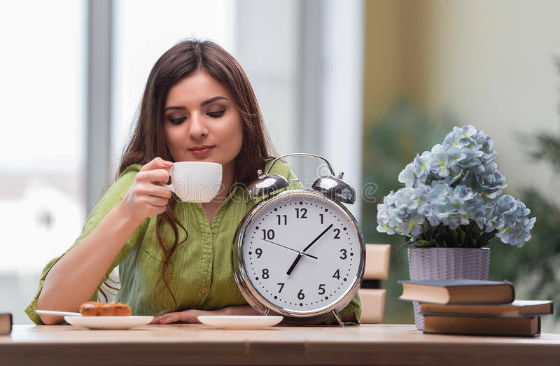 The student with gian alarm clock preparing for exams royalty free stock photos