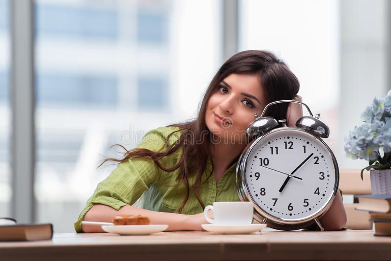 The student with gian alarm clock preparing for exams royalty free stock images