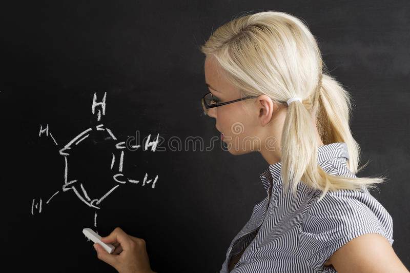 Student girl at blackboard stock photo