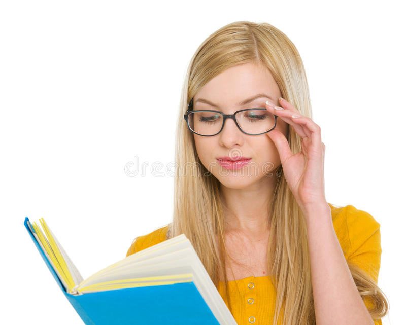 Student girl in glasses reading book royalty free stock photography