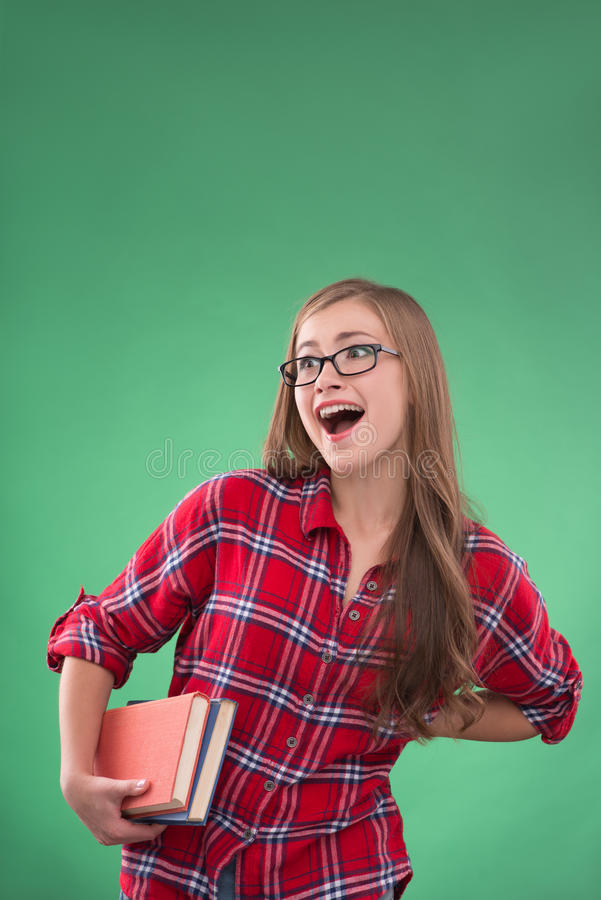 Student girl on green background royalty free stock image