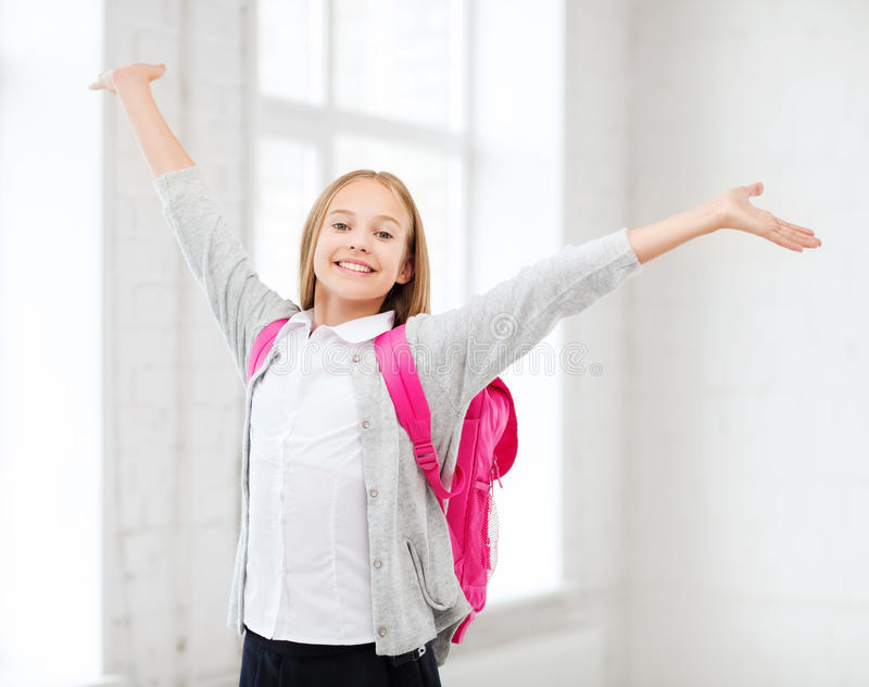 Student Girl With Hands Up At School Stock Photos