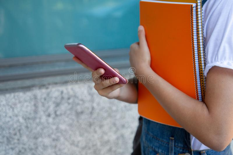 Student girl using smartphone at the college stock image