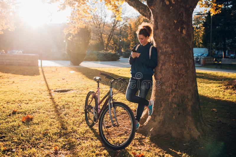 Student girl with mobil phone royalty free stock images