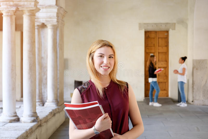 Student girl portrait holding books in her hands royalty free stock image