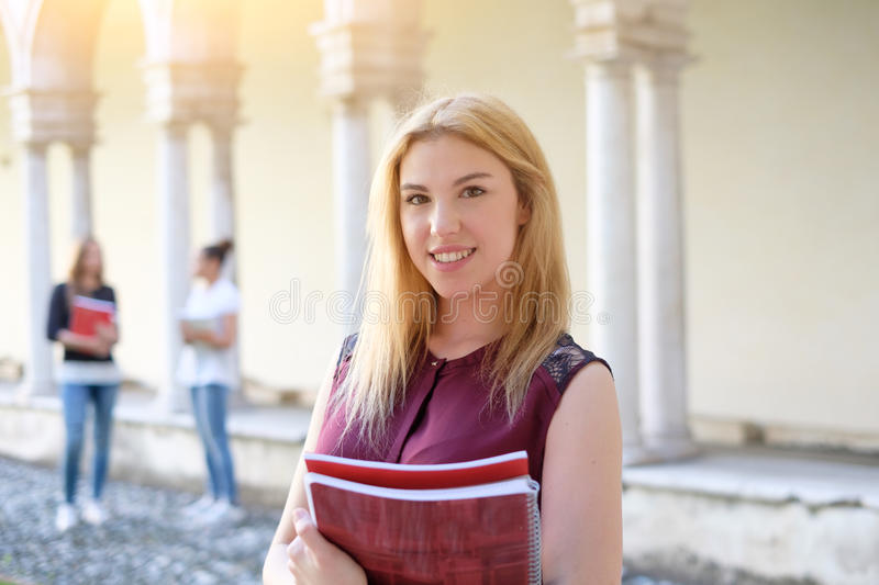 Student girl portrait holding books in her hands royalty free stock photos