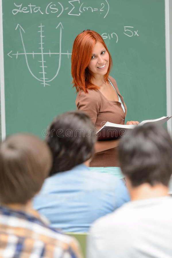 Student girl standing front of chalkboard math royalty free stock photos