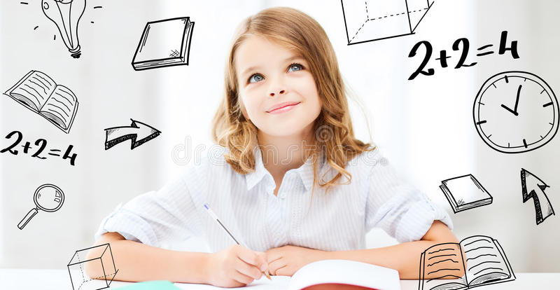 Student girl studying at school. Education and school concept - little student girl studying at school stock photo