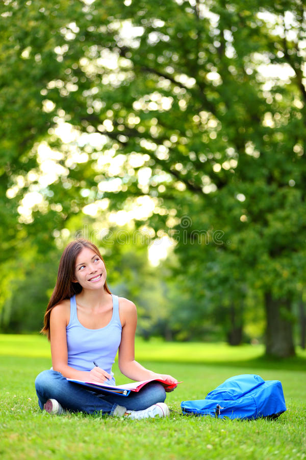 Student girl thinking looking in park stock photos