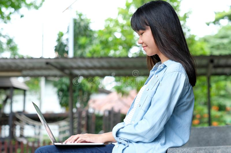 Student girl using laptop computer, online education,  adult learning concept. Student girl using laptop computer, online education, adult learning royalty free stock image