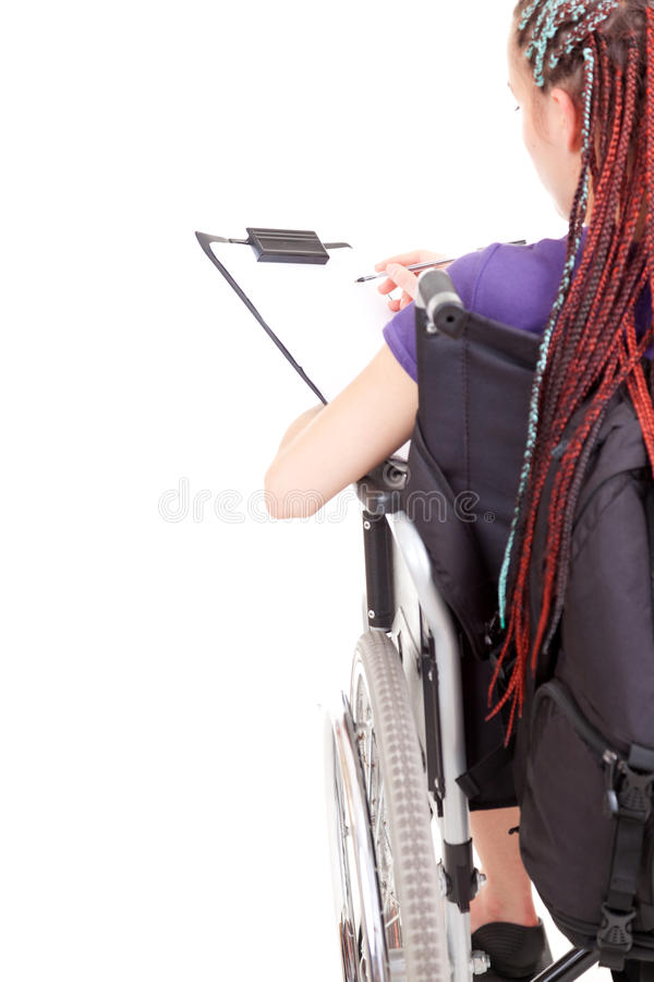 Download Student Girl On Wheelchair With Clipboard And Pen Stock Photo - Image: 26925646