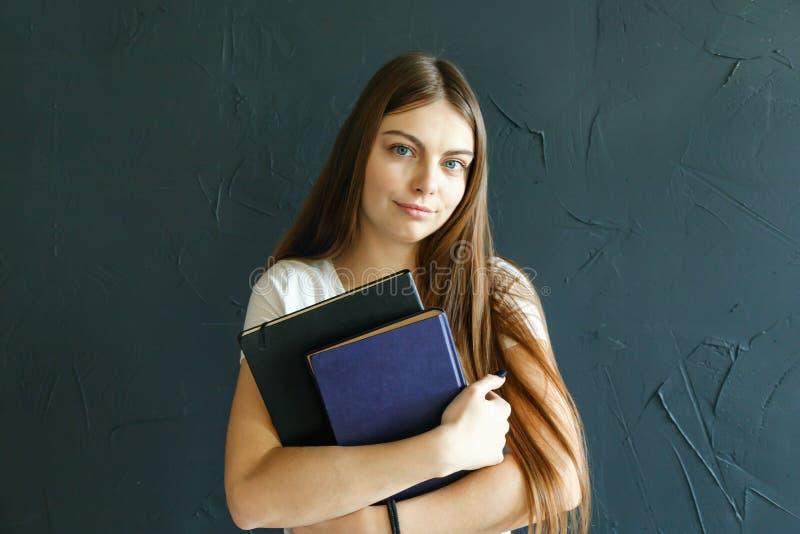 Student Girls Holding Books royalty-vrije stock afbeeldingen