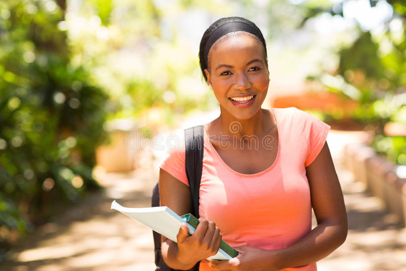 Student going to class. Pretty female africa college student going to class royalty free stock photos