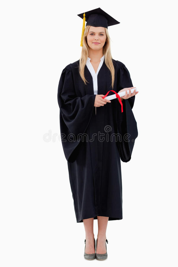 Student in graduate robe holding her diploma royalty free stock photography