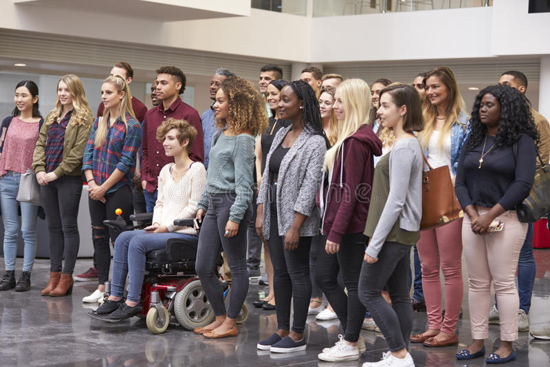 Student group standing in university atrium looking away stock photography