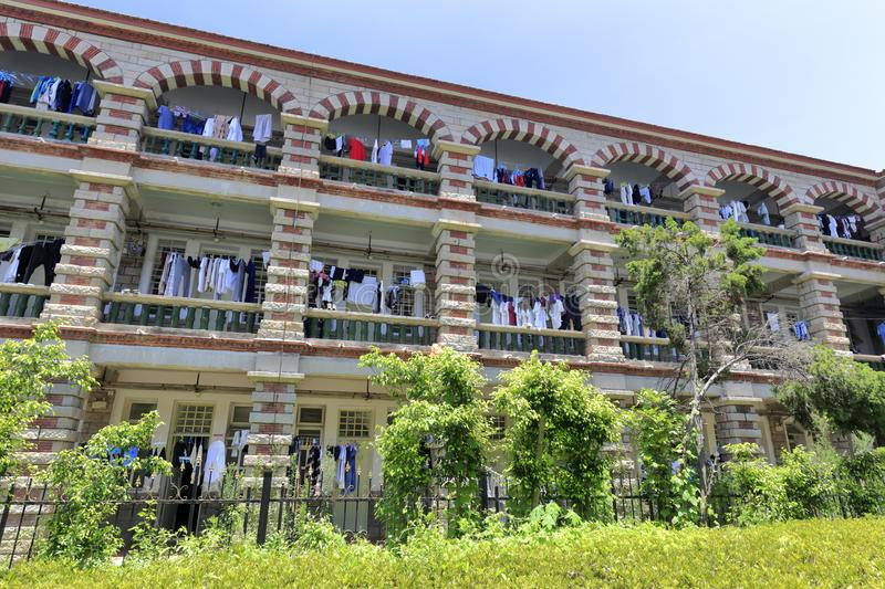 Dormitory of xiamen university, adobe rgb. Student hang and dry clothes on the balcony of hallway, xiamen university, china stock photos