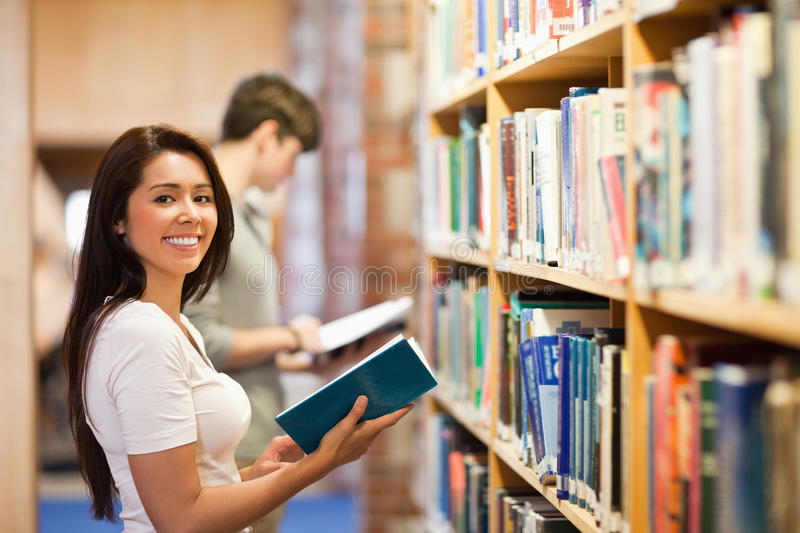 Student holding a book royalty free stock image