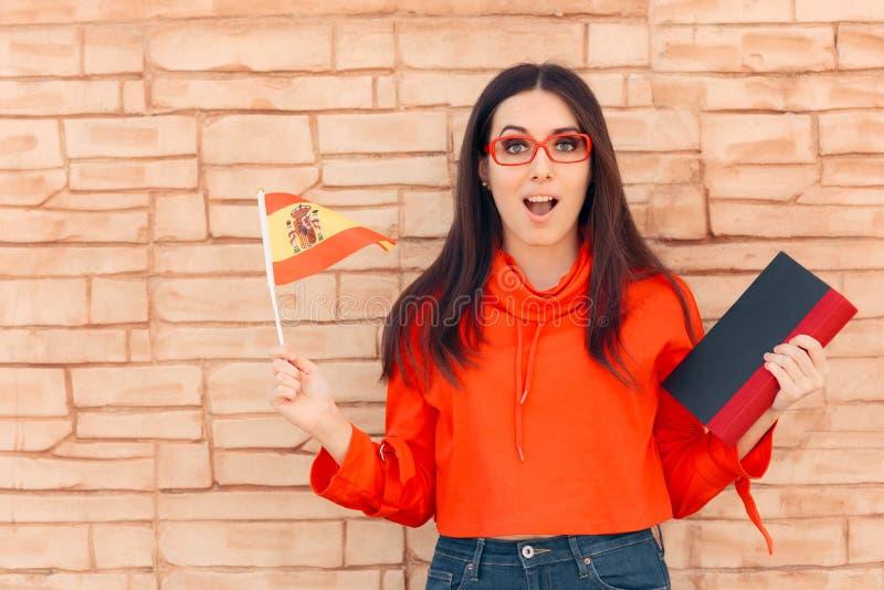 Student Holding Flag en Boekenkennis Vreemde taal royalty-vrije stock fotografie