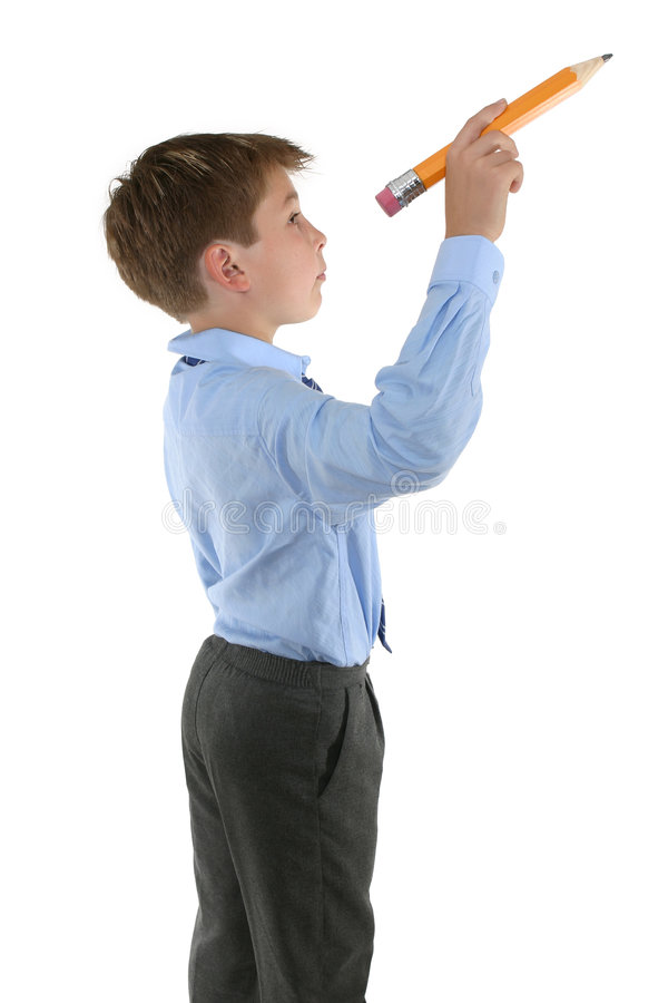 Student holding a pencil about to write royalty free stock image