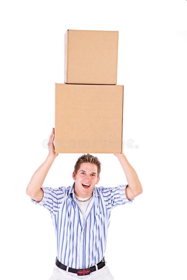 Student: Holding A Stack Of Packing Cardboard Boxes Aloft royalty free stock images