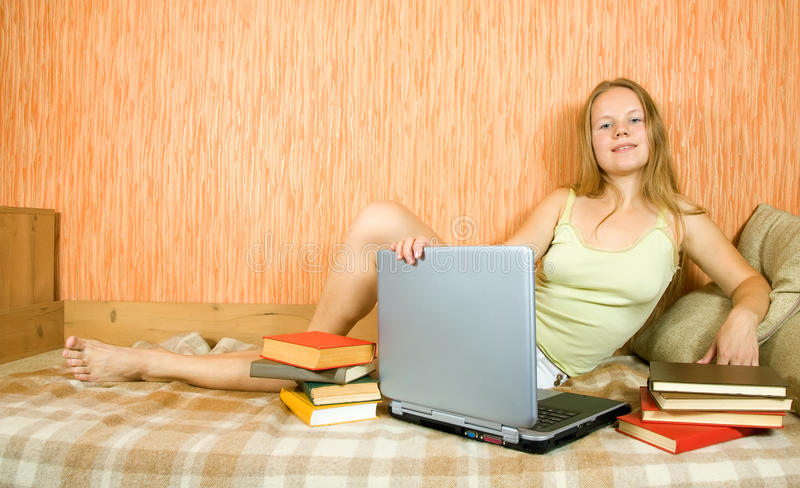Student with laptop and books stock photography
