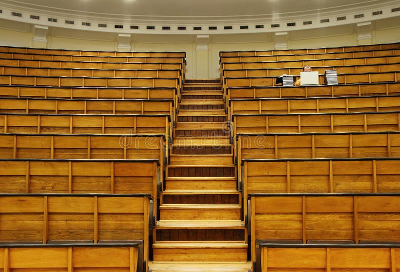 Student with laptop in lecture hall royalty free stock photos