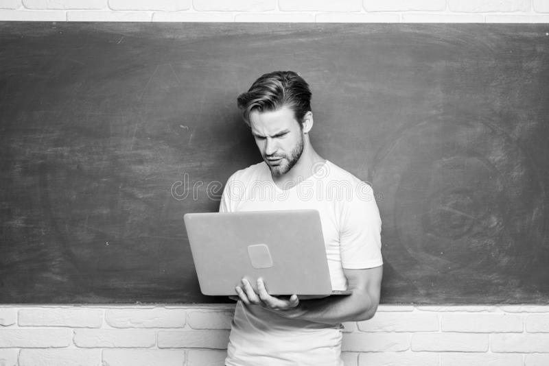 Student learn programming language. School teacher programming with laptop. Handsome man use modern technology. Digital royalty free stock images