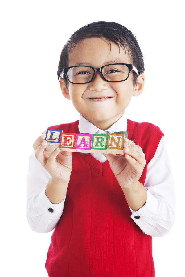 Student with letter blocks royalty free stock images