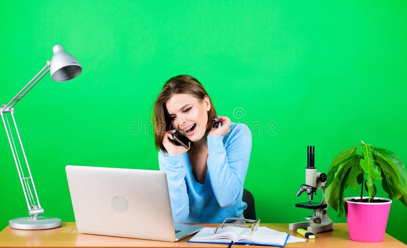 Student life. High school education. Calling friend. Online remote classes. Buy online. Talking instead of studying. Girl pretty attractive student with laptop royalty free stock image