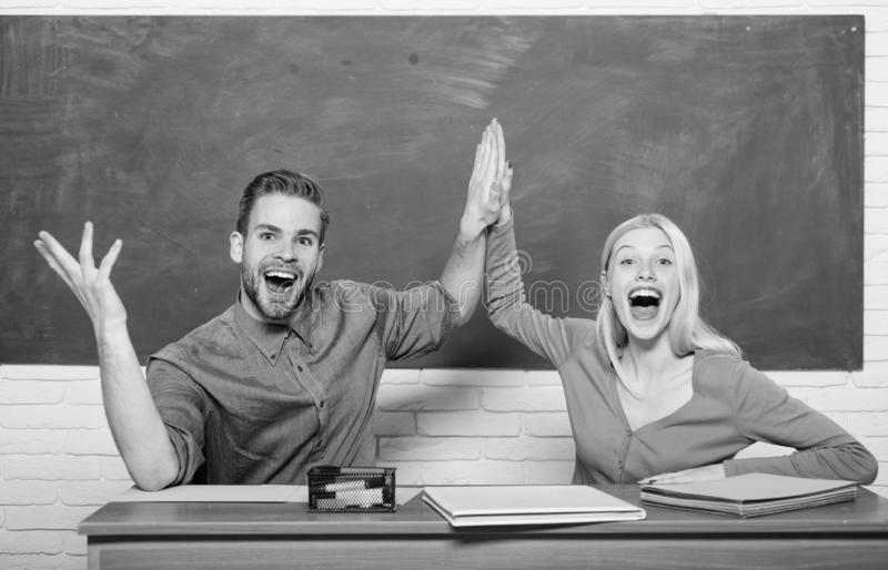 Student life. Lesson and blackboard. Teachers day. Modern school. Knowledge day. Couple of man and woman in classroom stock photography
