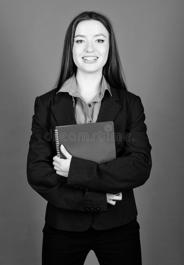 Student life. Smart beauty. happy nerd. girl student in formal clothes. business fashion. Schoolgirl with document. Folder. woman in jacket with paper notes stock photography
