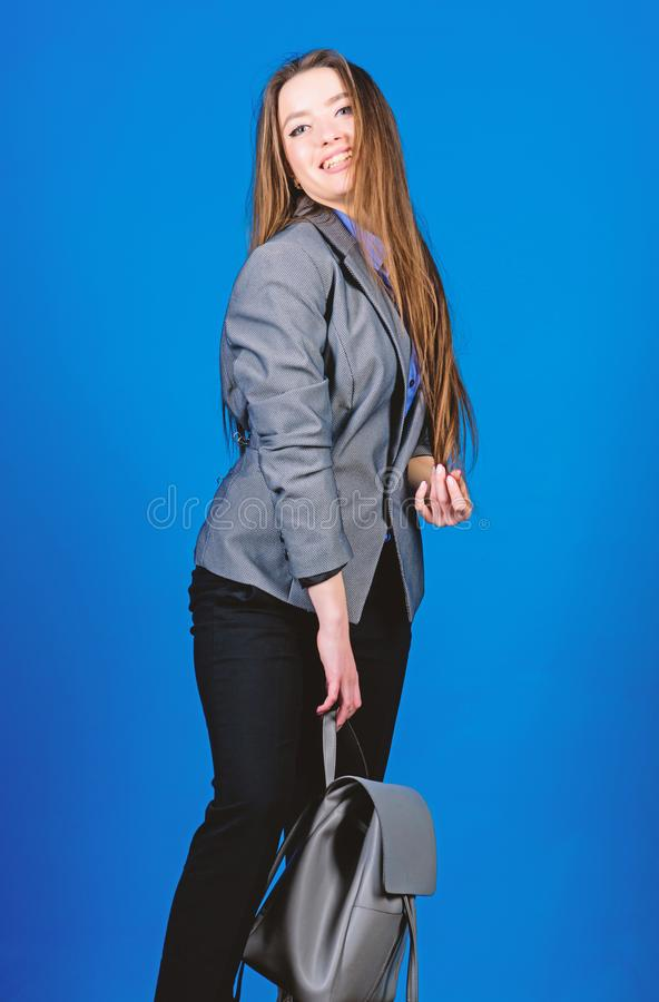 Student life. Smart beauty. Nerd. business. Shool girl with knapsack. female bag fashion. stylish woman in jacket with. Leather backpack. girl student in formal royalty free stock photo