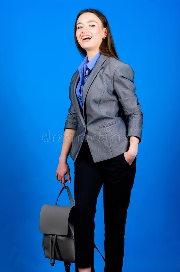 Student life. Smart beauty. Nerd. business. Shool girl with knapsack. girl student in formal clothes. stylish woman in. Jacket with leather backpack. female bag stock photo