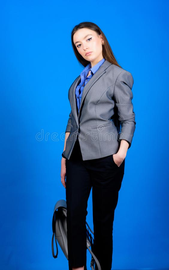 Student life. Smart beauty. Nerd. girl student in formal clothes. stylish woman in jacket with leather backpack royalty free stock photography
