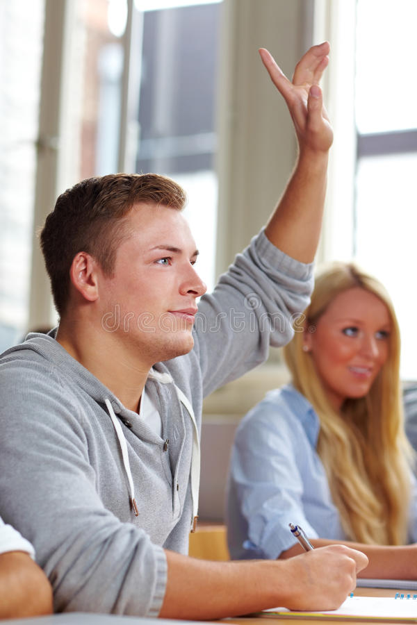 Download Student lifting his finger stock image. Image of classroom - 21304465
