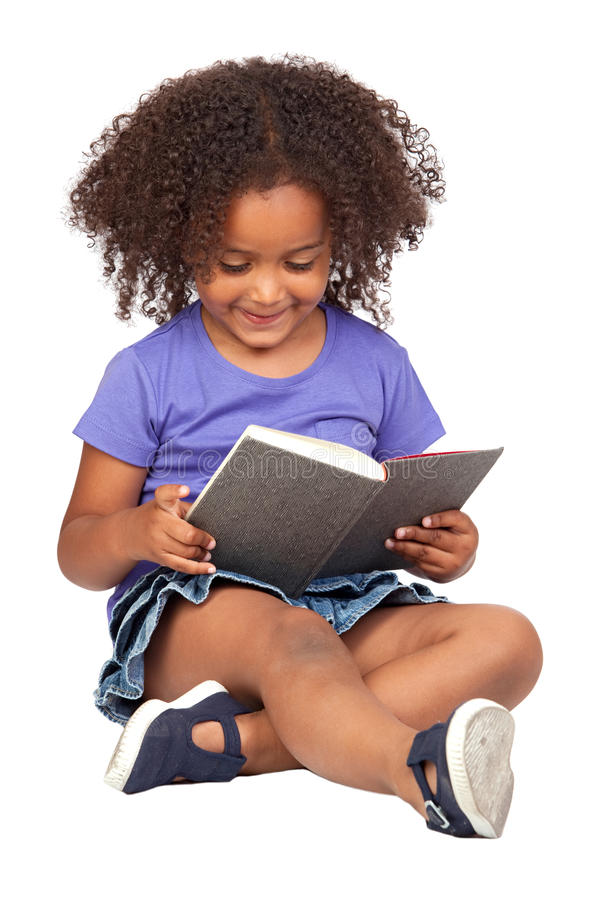 Student little girl reading with a book royalty free stock photo