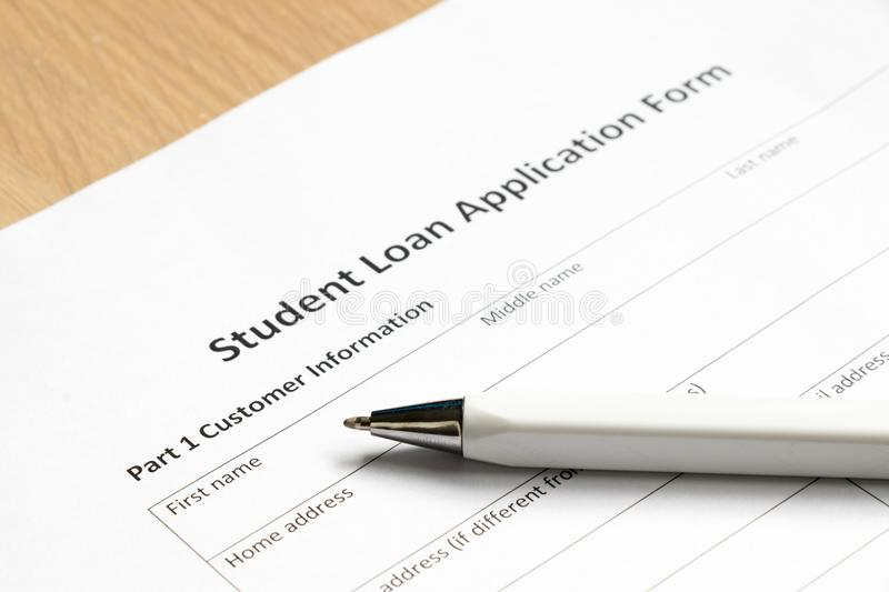 Student loan application form wth pen on desk stock images