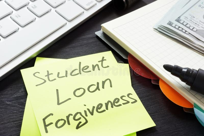 Student loan forgiveness written on a memo stick. Student loan forgiveness written on the memo stick stock image