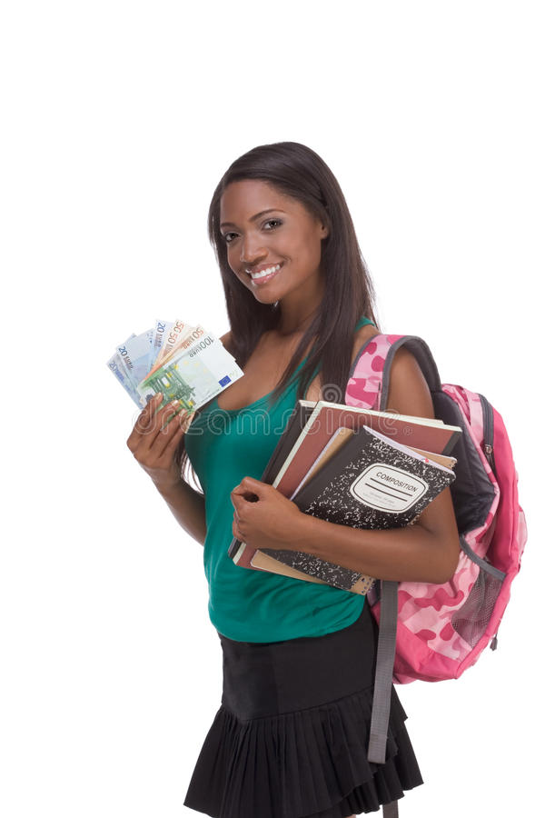 Student with loan money and financial aid. Education financial aid Ethnic black African-American college student holds pile 100 (one hundred), 50 (fifty) and 20 stock images