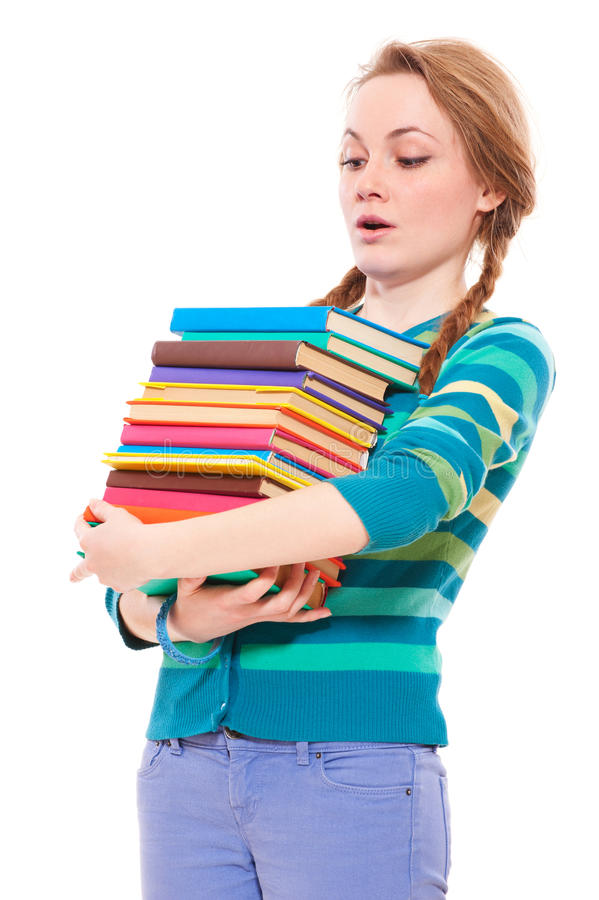 Download Student Looking To Pile Of Books Stock Photo - Image: 19411872