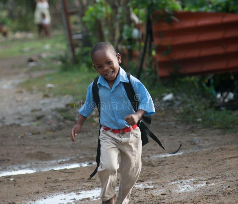 Joyful kid in Los bateyes Community stock images